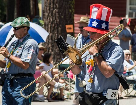 Graeagle, California, USA- July 5, 2015: The Ophir Prison Marching and Kazoo Band performing while marching in the Mohawk Valley Independence Day Celebration in this small northern California town.