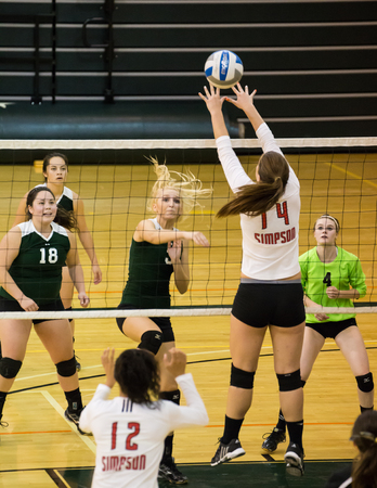 Simpson University against Shasta College in a volleyball match in Redding, California.
