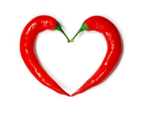 Two chili peppers forming a shape of heart  Hot lover symbol