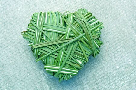 heart shaped from green grass