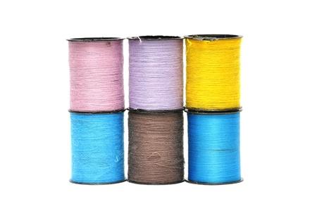 coloured bobbins thread isolated on white