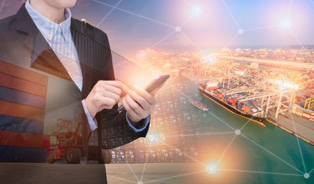 Double exposure asian business woman use smart technology with container shipping boat at shipping yard.Photo concept for Global business shipping,Logistic,Import and Export industry.