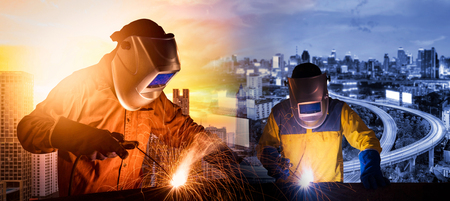Photo pour Welding worker welding steel structure with expressway and modern city in background for construction industrial work concept - image libre de droit