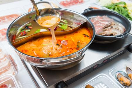 Foto de Dishes prepared with medicinal herbs pan Chinese food(Hot pot) - Imagen libre de derechos
