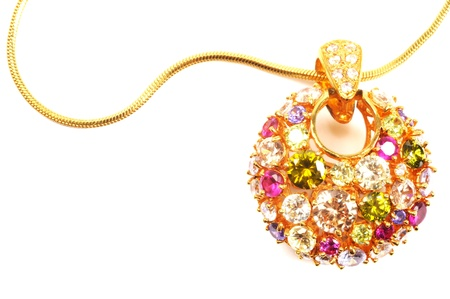 Golden necklace with colorful gems , over white
