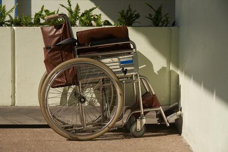 Photo pour A brown wheelchair parking in the hospital. - image libre de droit