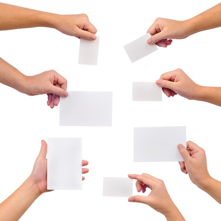 Photo pour Collection of blank cards in a hand isolated on white - image libre de droit