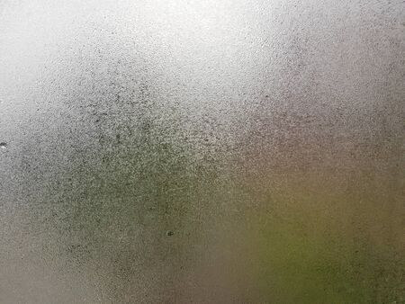 Foto de Transparent glass with fog up and water drop on it during winter season with Cold hand writing letter on it. Close up shot of Natural beauty effect. Background and wallpaper concept. - Imagen libre de derechos