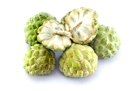 Custard apples group and  opened one on white background with isolate.