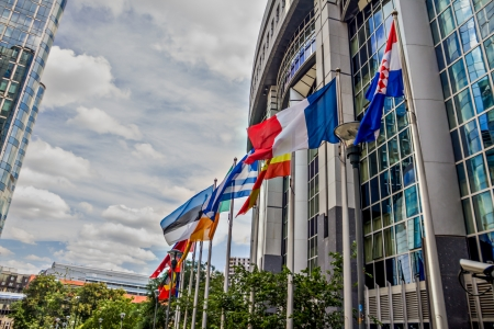 EU parliament building in brussels with country flags