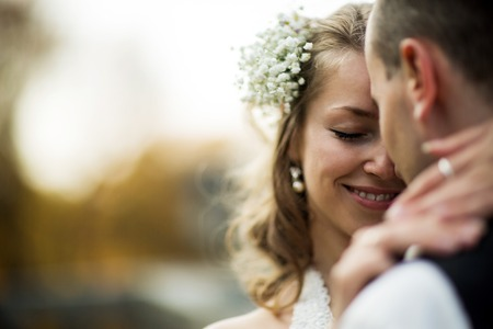Photo for beautiful couple enjoying embrace of each other and tenderly smiling - Royalty Free Image