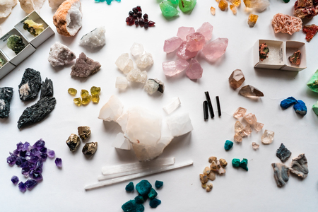 Foto de Collection of beautiful precious stones on white table. - Imagen libre de derechos