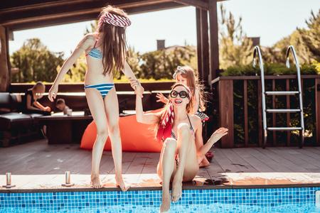 Photo pour Happy mother and two daughters have fun - image libre de droit