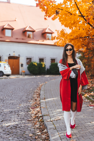 Photo for Fashion portrait of beautiful woman in autumn park - Royalty Free Image