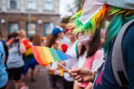 Foto de Happy crowd waving lgbt flags during Pride Parade - Imagen libre de derechos