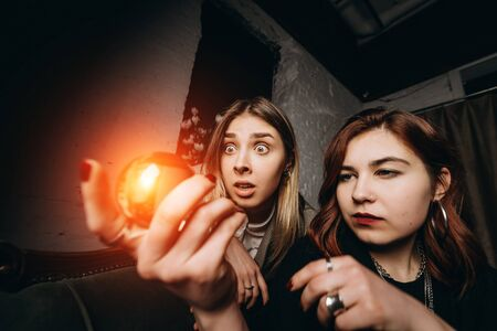 Photo for Woman and woman fortune teller with crystal ball - Royalty Free Image