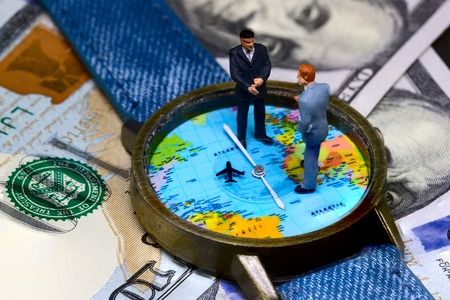 Photo pour Two businessmen figurines on time and money background. Worldwide business concept. International business agreement. Global corporation strategic partnership. Global business profit. Global market - image libre de droit