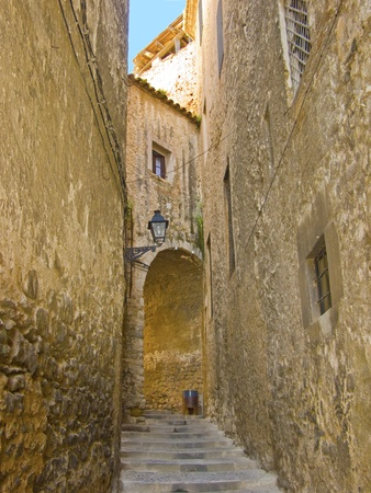 Narrow and old street in Girona city (Spain), medieval zone