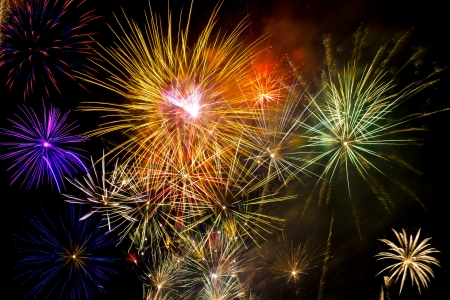 Colorful fireworks over dark sky during a celebration