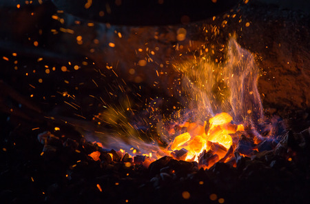burning charcoal with fire and sparks