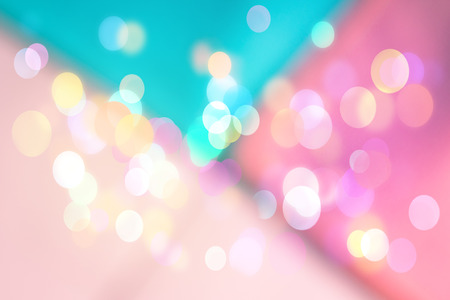 Photo pour Abstract geometrical blurred background with sparkling light bokeh. Festive pink and turquoise backdrop - image libre de droit