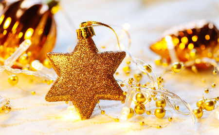 Christmas and New Year decorations star on yellow lights background