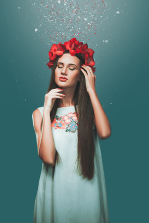 art photo of a girl on a dark blue background with flowers in my head