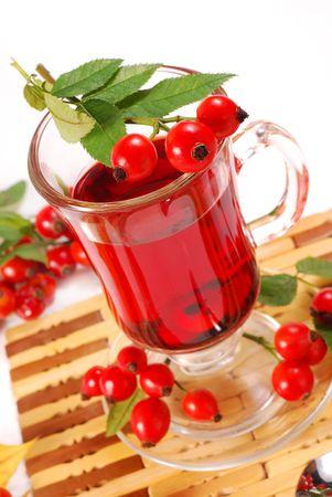 glass of fresh herbal rose hip tea