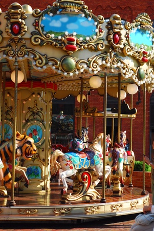 beautiful vintage merry-go-round with horses  and other animals for kids