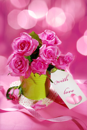 bunch of roses and paper tag with text on pink background