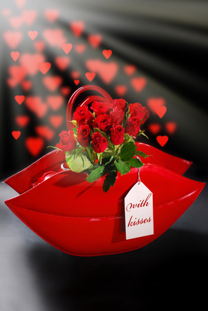 lips shaped red bag with paper tag and bunch of roses on black background