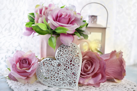 Photo pour romantic decoration with hearts,roses and lanterns in shabby chic style for wedding or valentine`s day - image libre de droit