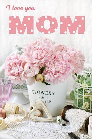 Foto de bunch of beautiful pink peonies in metal bucket for Mother's Day with inscription I love you mom - Imagen libre de derechos