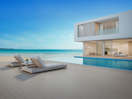 Photo pour Luxury beach house with sea view swimming pool and terrace in modern design Lounge chairs on wooden floor deck at vacation home or hotel - 3d illustration of contemporary holiday villa exterior - image libre de droit