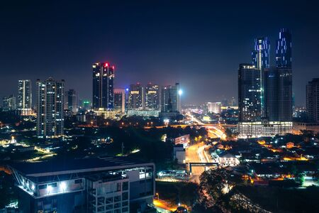 Photo pour Johor Bahru, Malaysia, at night. Malaysian city with traffic on highway and modern business buildings and hotels in downtown. Scenic urban skyline and cityscape. Aerial view. - image libre de droit