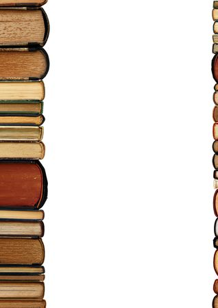 A pile of old books as a colorful border isolated on white background with copy space area