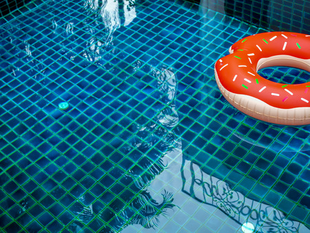 Pool Float Ring are Floating on Swimming Pool Background ...