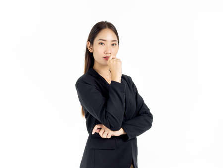 Photo for Portrait of serious young pretty Asian businesswoman in black suit looking camera isolated on white background. - Royalty Free Image