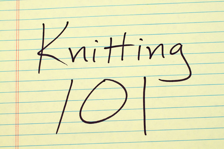 The words Knitting 101 on a yellow legal pad