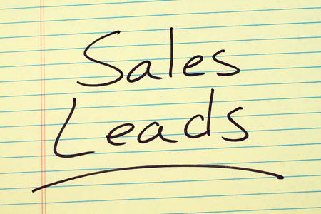 The word Sales Leads underlined on a yellow legal pad