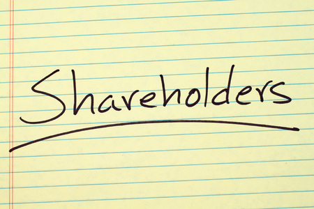 The word Shareholders underlined on a yellow legal pad