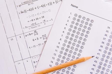 Photo pour Pencil on answer sheets or Standardized test form with answers bubbled. multiple choice answer sheet - image libre de droit