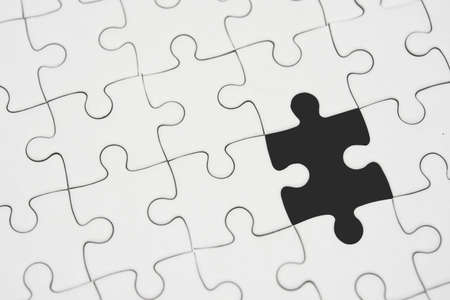 Photo for White jigsaw puzzle pattern background. placing last piece of jigsaw puzzle - Royalty Free Image