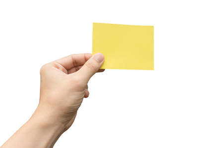 Photo pour Hand holding yellow paper isolated on white with clipping path - image libre de droit