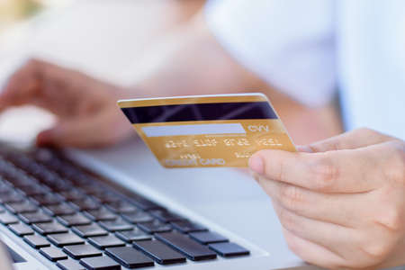 Foto de Online Payment . Woman hands holding credit card and using laptop. Online shopping - Imagen libre de derechos