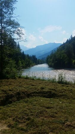 a river in the austrian alps in the summer