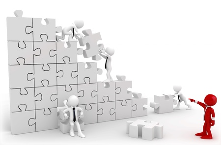 Photo pour Director and employees working together to put the pieces of a puzzle - image libre de droit
