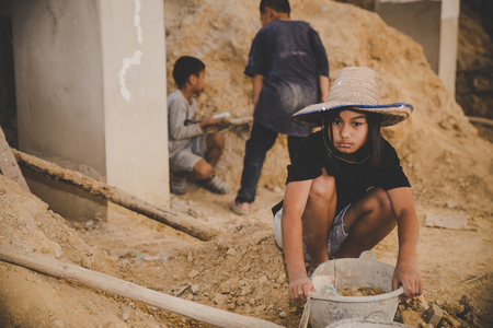 Photo for Little boys and girls labor working in commercial building structure, World Day Against Child Labour concept. - Royalty Free Image