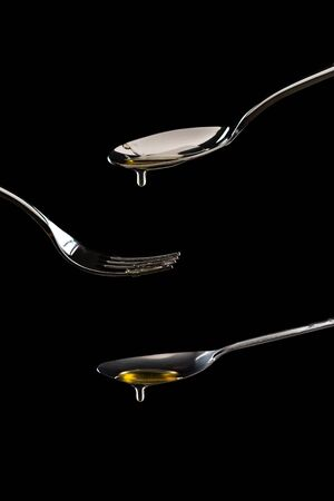 golden sweet honey dripping from spoon anthracite isolated
