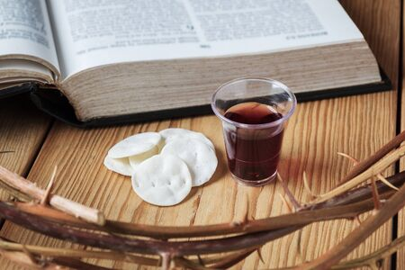 Photo for Holy Communion, a Cup of Wine and Bread with a Jesus Crown Thorn and Holy Bible. - Royalty Free Image